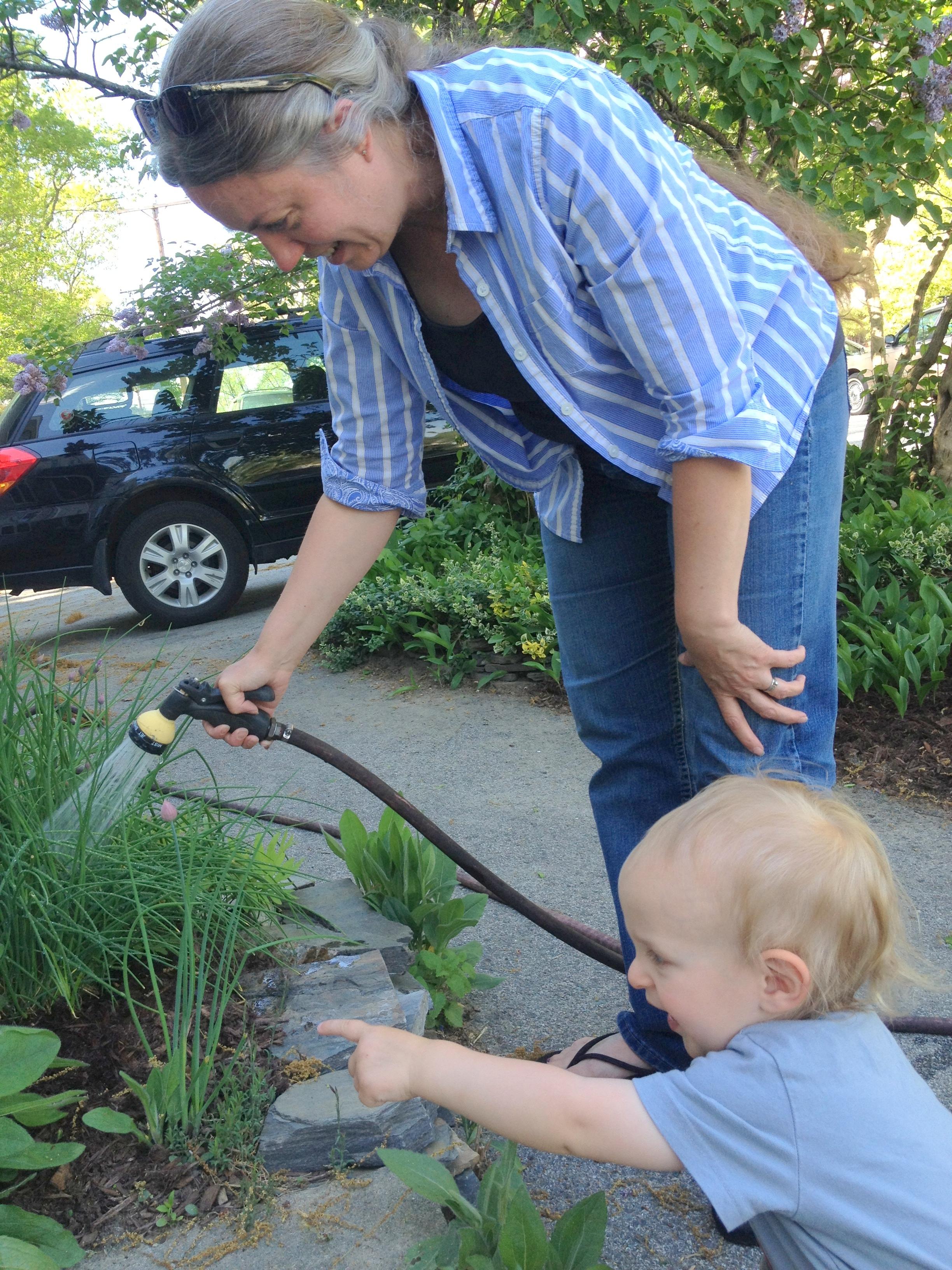 My grandson, Elias, helping me water my flowers