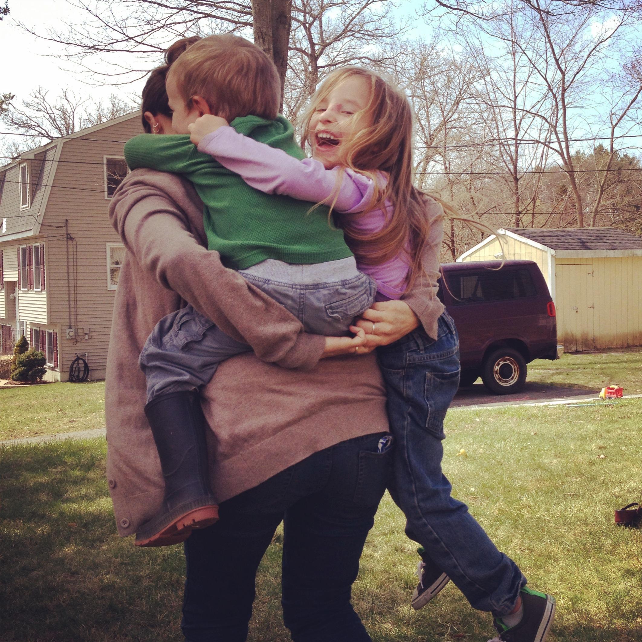 Cassie giving her kids a piggyback ride