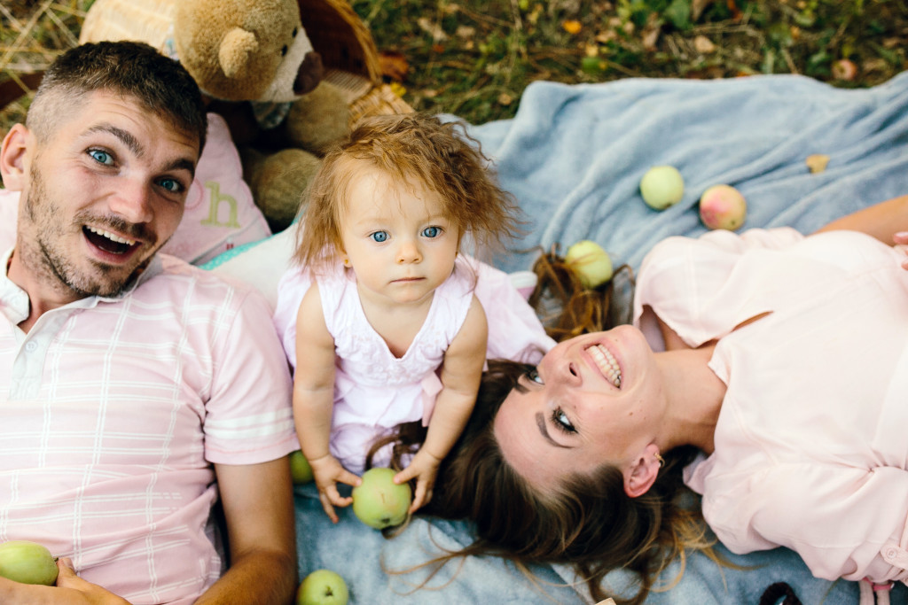 Happy family on the lawn in the park